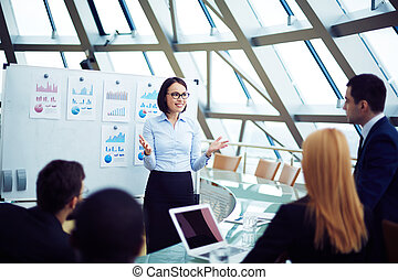 Explaining strategy - Young female manager holding briefing