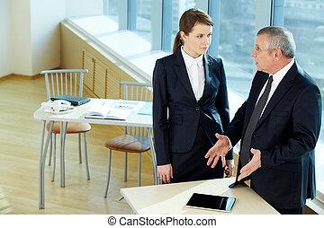Explanation - Boss explaining something to secretary in...