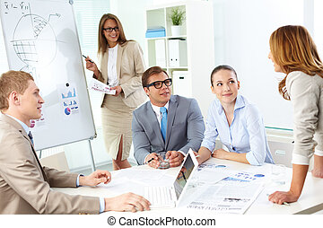 Explanation - Confident co-workers listening to top manager...