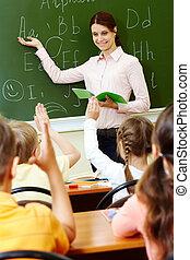 Explanation of teacher - Portrait of smart teacher pointing ...