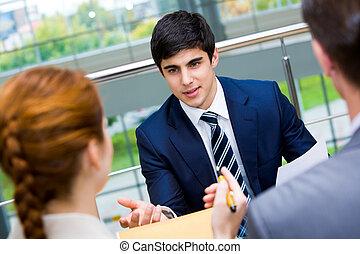 Explanation - Portrait of confident businessman sharing his ...