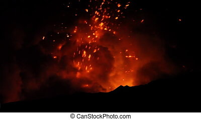 Lava exploding out from a lava tube in Hawaii at night