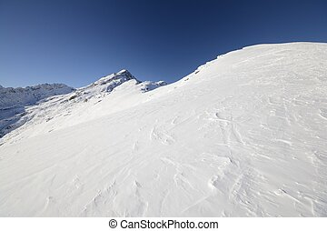 Back country skiing in scenic landscape. Location: italian Alps, Locana Valley, Gran Paradiso National Park, Piedmont.
