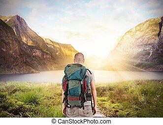 Explorer find a lake in beautiful landscape