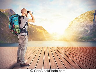 Explorer in a lake - Explorer observes a lake in the ...