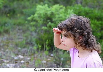 explorer little girl forest park searching hand in forehead