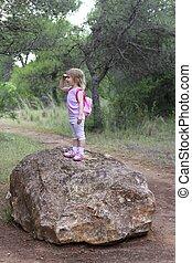 explorer little girl forest park searching