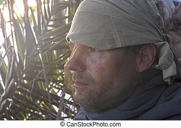 Explorer wearing mosquito net - Closeup profile portrait of ...