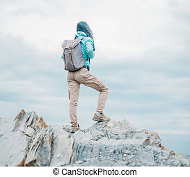 Explorer young woman with backpack