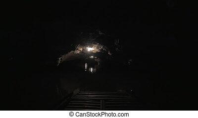 Exploring the dark karst cave in Trang An, Vietnam