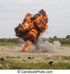 Explosion - Automobile that has just exploded and flames are...