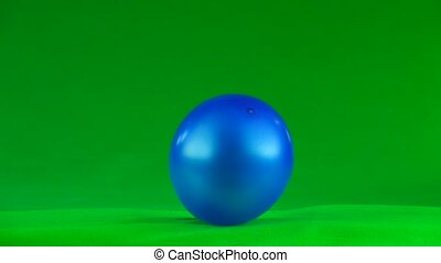explosion of a blue balloon on a green background