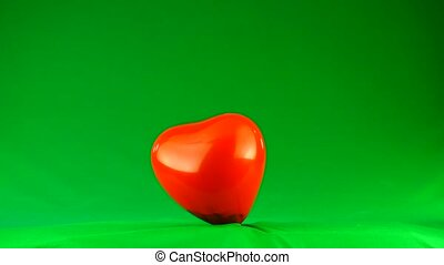 explosion of a red balloon on a green background