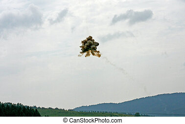 explosion of a surface-to-air missile over the mountains during a war in war zones