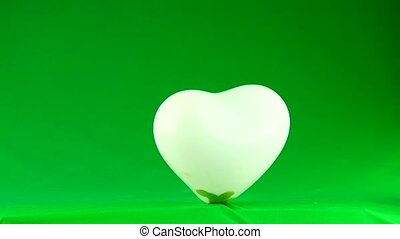 explosion of a white balloon on a green background