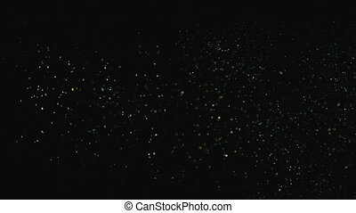 Explosion of gold sparkles falling in the form of rain on a black background