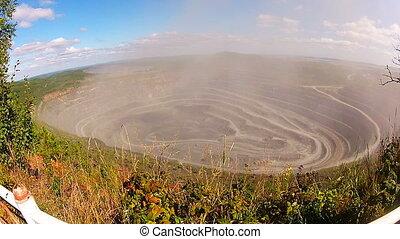 Explosion rocks in a quarry. Mining. Rewind.