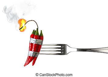 Explosive Food - fork with group of red chilli peppers with...