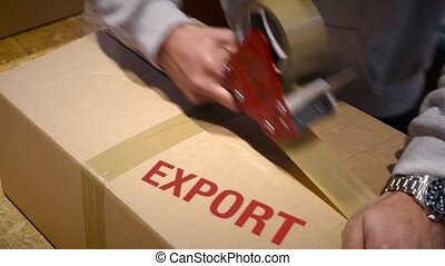 Export goods package for shipment - Production worker...