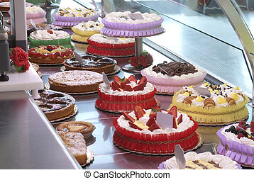 exposition of various cakes in a pastry shop
