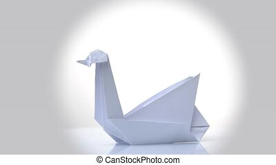 Exposition of white paper origami swan. White bright...