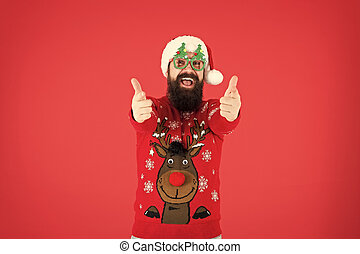 Express positivity. merry christmas. hipster man reindeer on knitted sweater. winter holiday. cold season clothes. happy new year. santa man party glasses. cheerful santa thumbs up. best xmas ever