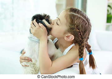 Expressing affection - Portrait of happy girl kissing...
