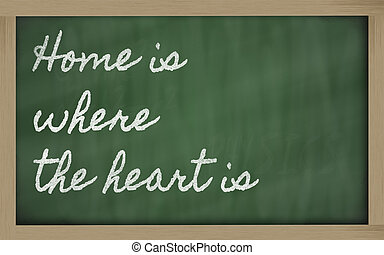 expression -  Home is where the heart is - written on a school b