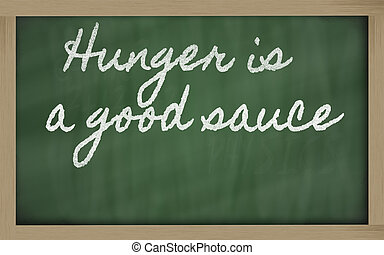 expression - Hunger is a good sauce - written on a school blackb