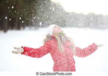 Portrait of beautiful woman taking pleasure on snowy winter day