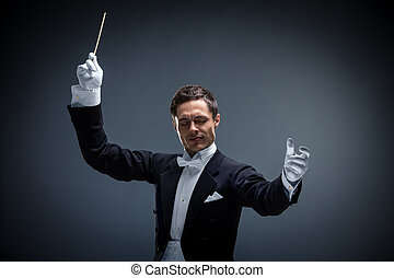 Expression - Young man in tuxedo conducting