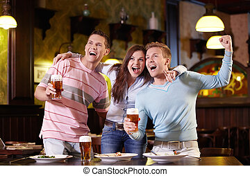 Expression - Young people rejoice at the pub