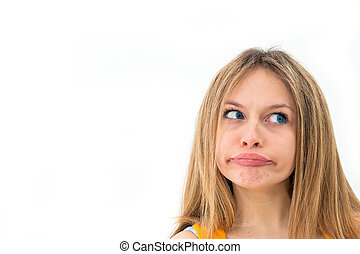 Young woman making a funny grimace - expression-Young woman...