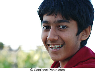 expressions - a young boy with braces