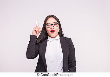 Expressions and people concept - young asian woman in glasses showing idea gesture over white background.