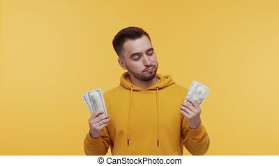 Expressive and happy man with a bunch of money. Person who ...
