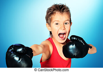 expressive boxing - Portrait of a sporty boy engaged in...