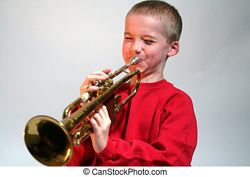 Expressive Boy Hitting Trumpet Note