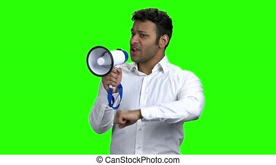 Expressive businessman talking in megaphone. Young...