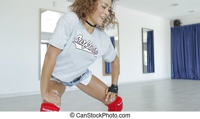 Expressive dancer in motion - Young sportive girl in shorts...