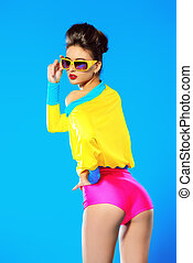 eyewear - Expressive fashion model posing in vivid colourful...
