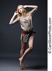 Expressive fashion portrait of young woman on dark background