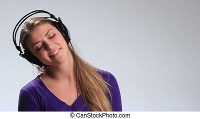 Expressive girl in headphones enjoying music