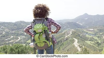 Expressive happy traveler - Back view of young happy woman...