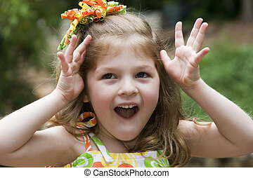Expressive little gi - Cute girl playing