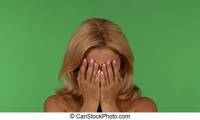 Expressive mature woman showing different emotions - Studio...