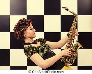 Beautiful saxophone player in retro style. Professional musician. Beat generation.