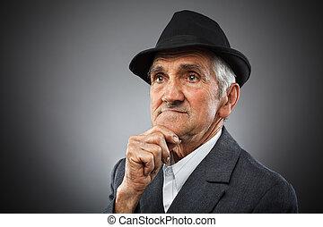 Expressive senior portrait - Studio portrait of an...
