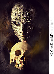 expressive - Mysterious man in iron mask holding skull....