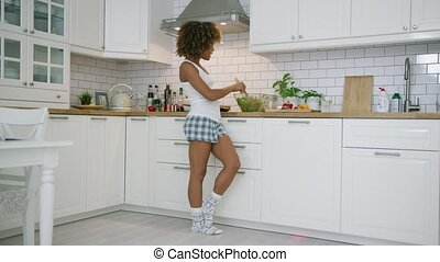 Expressive woman cooking in kitchen